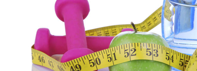 Diet diabetes concept with tape measure organic green apple